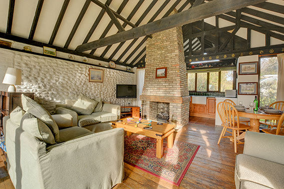 Photo of Pilgrims Chase sitting room, view 1