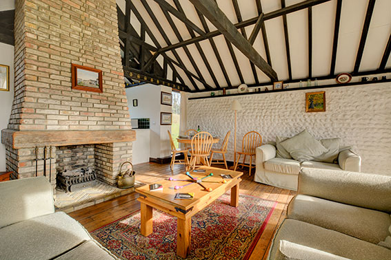 Photo of Pilgrims Chase sitting room, view 2
